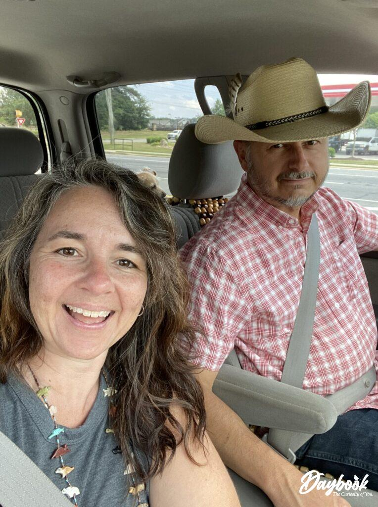 two people in truck traveling