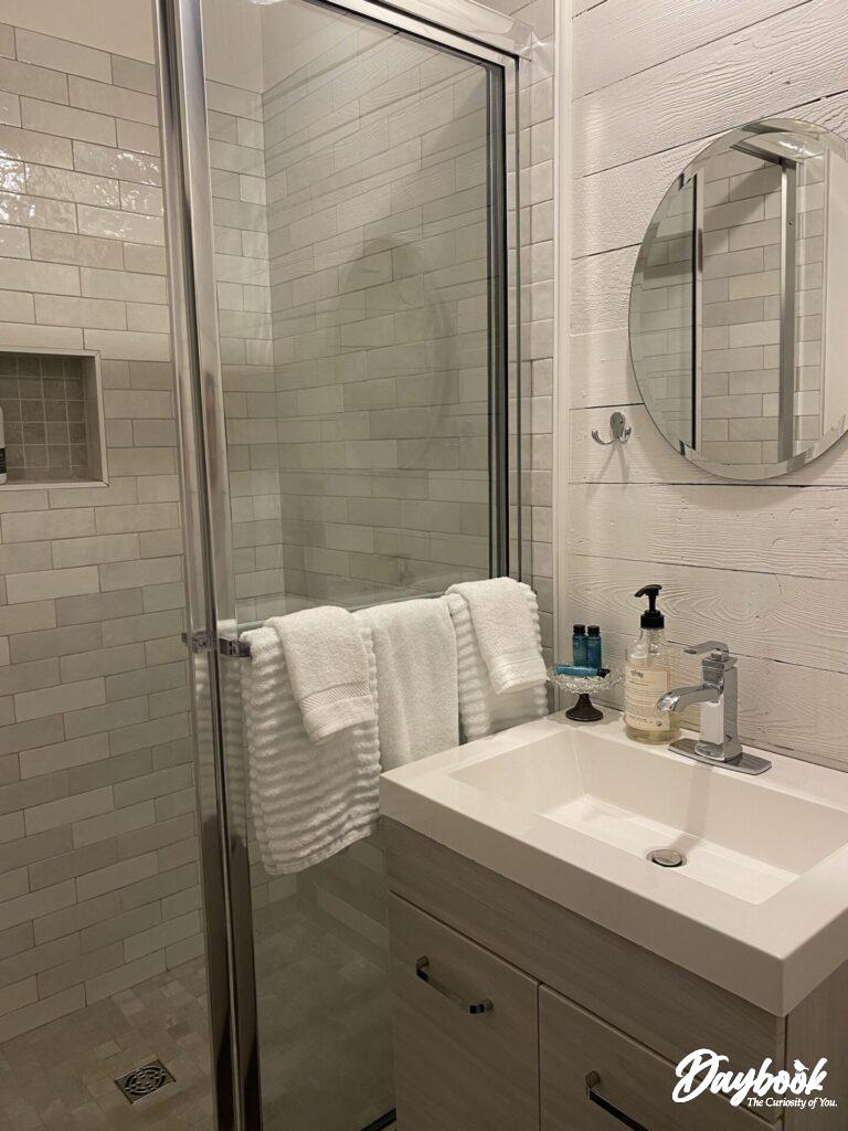 sink and shower in bathroom