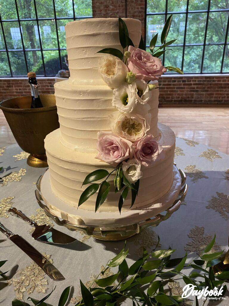 three layer wedding cake with flowers