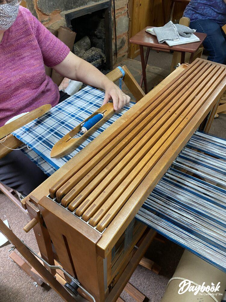 Artisan weaving on a loom