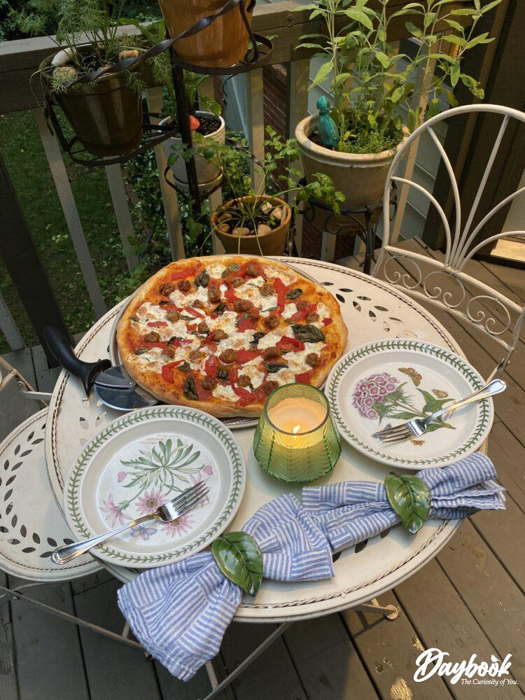 outdoor table set with pizza