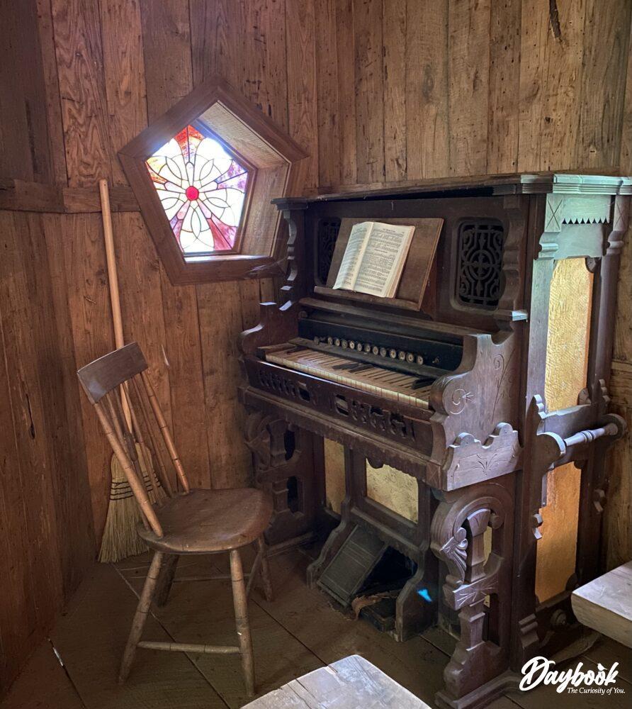 piano inside a primitive church