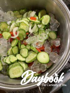 cucumbers, onions, and peppers in ice bath