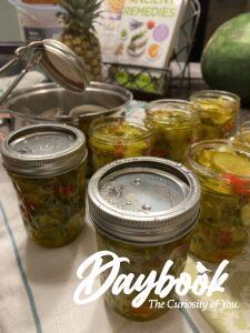 placing lids on jars of pickles
