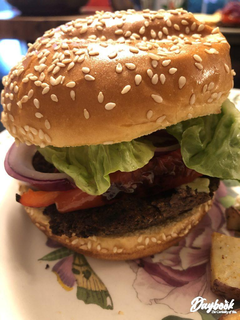 Hamburger with onions and lettuce