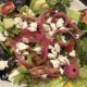 Large Greek salad with pickled red onions
