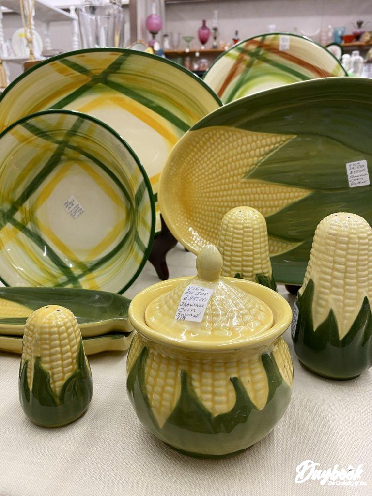 Antique yellow and green dishes with corn motif