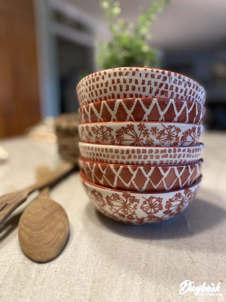 stack of white and rust-colored bowls