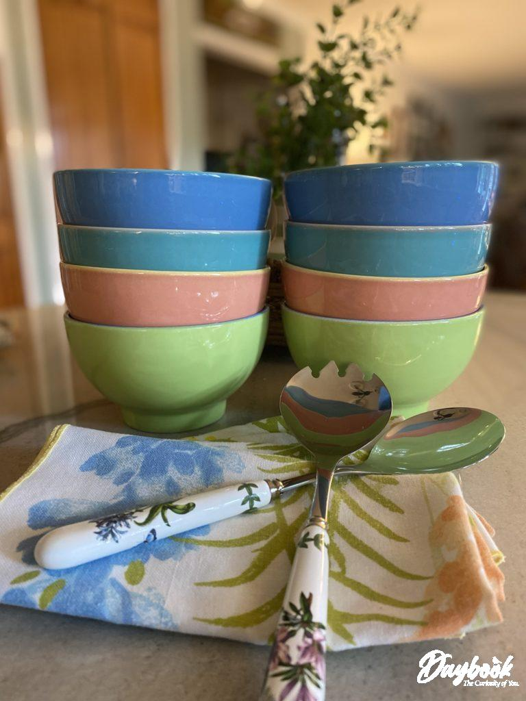 2 stacks of multi-colored bowls
