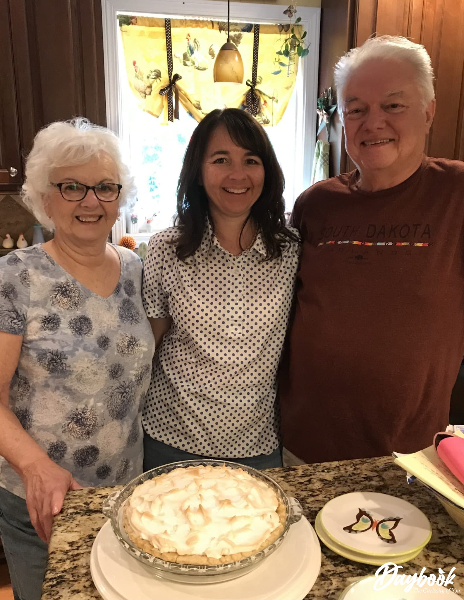 mom daughter and father in a kitchen