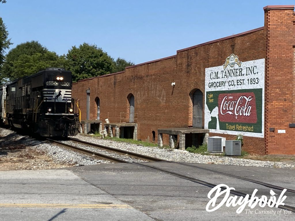 Railroad track running in front of a brick building