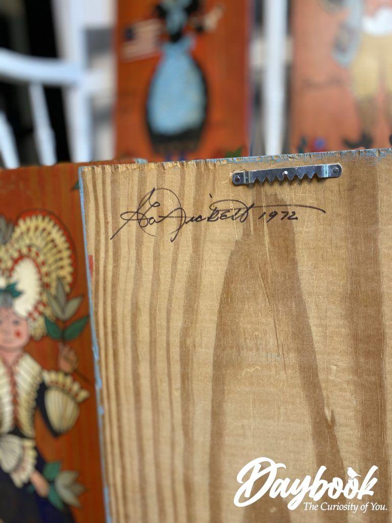Full artist signature on back of folk art painting