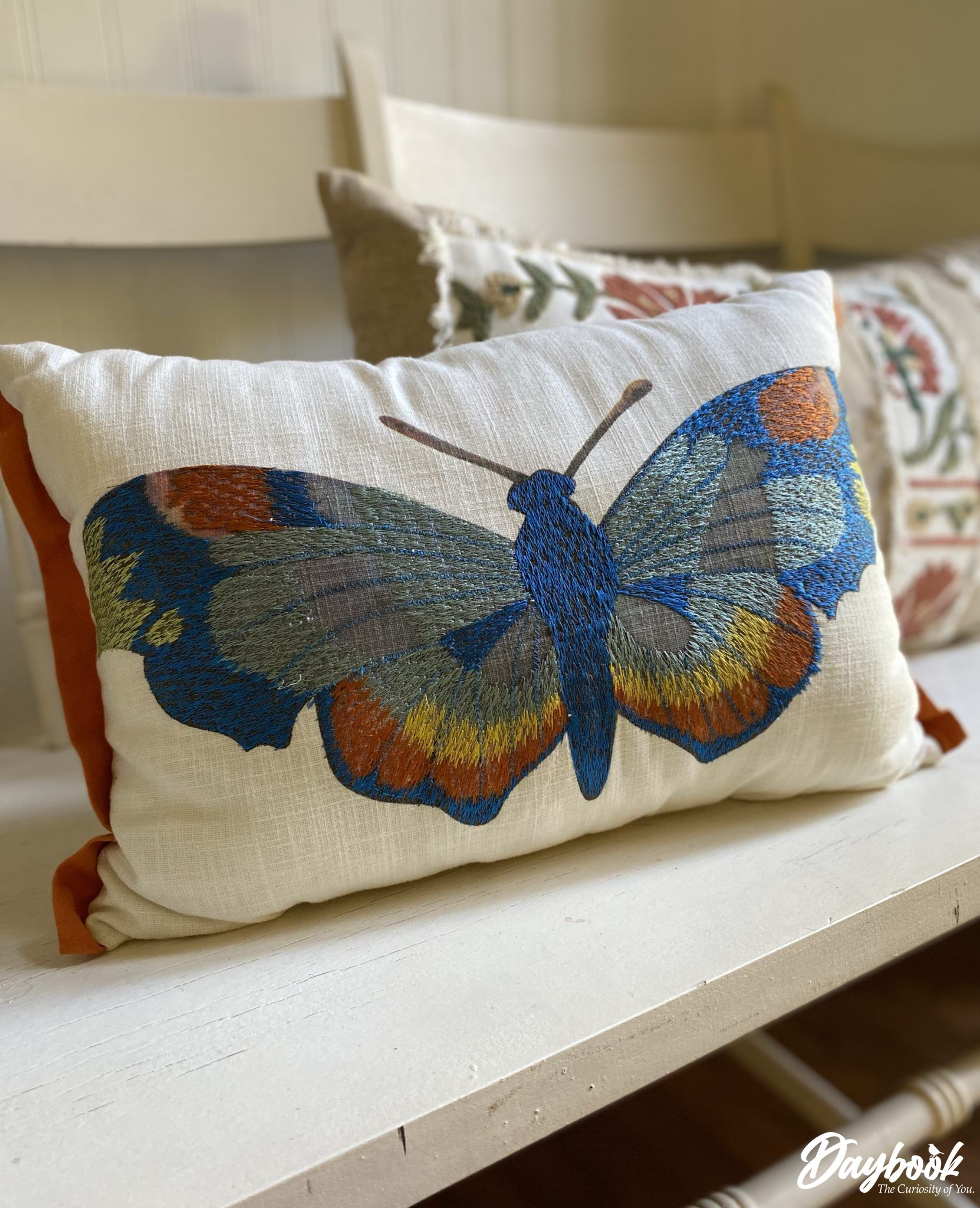 butterfly needlework on a throw pillow