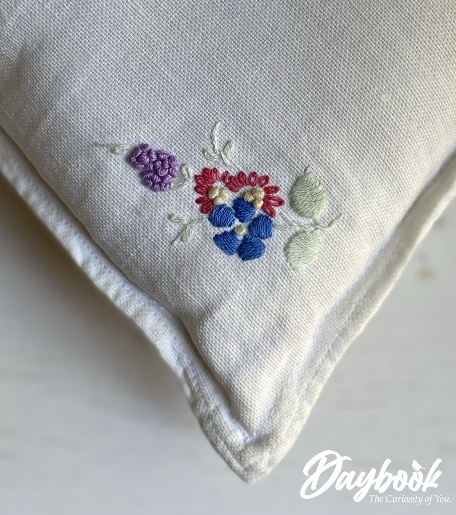 embroidered pillow corner