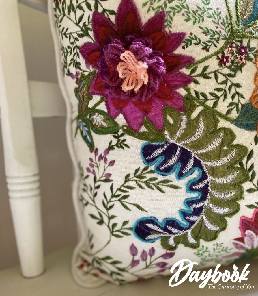 bright colored embroidered floral pillow