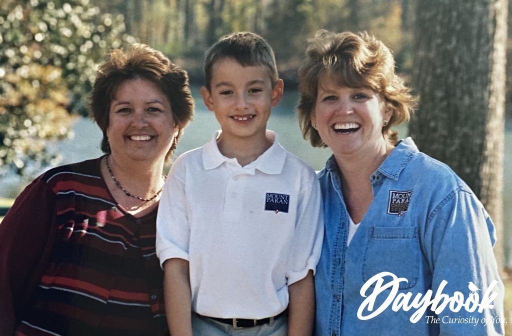 Mrs. Goodmand and Mrs. Chandler with Solomon in 2nd Grade outside