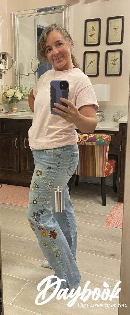 girl in a pair of embroidered jeans