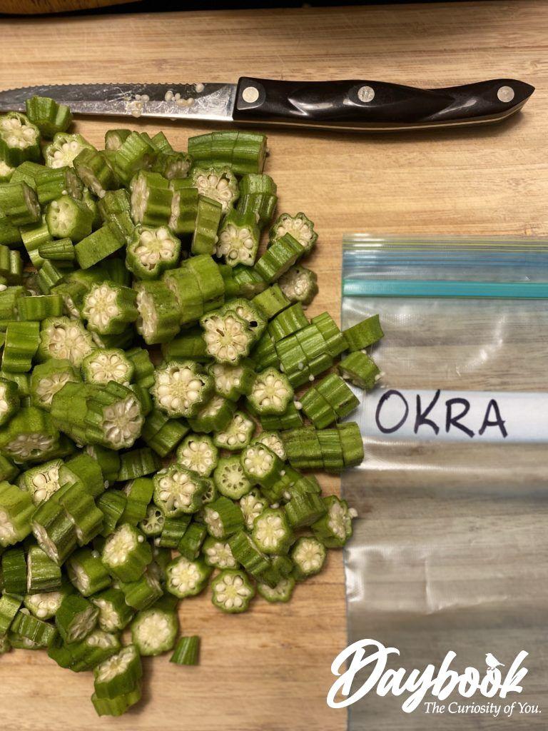 sliced okra next to a labeled freezer bag